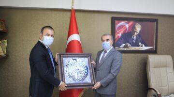 Başkan İbaş Nevşehir Milli Eğitim Müdürü Murat Demir'i ziyaret etti